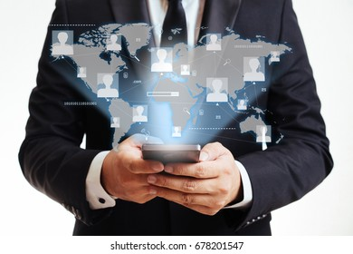 Communication technology concept with businessman using smart phone to connect to the world