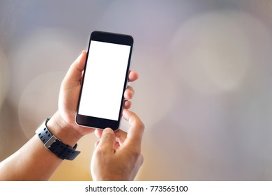Communication and Technology Concept. Close up of man with smartphones with blurred background.