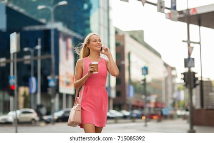communication, technology and people concept - happy smiling young woman with coffee calling on smartphone on city street