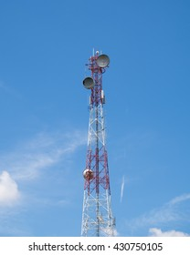 Communication tower antenna center on blue sky and clouds