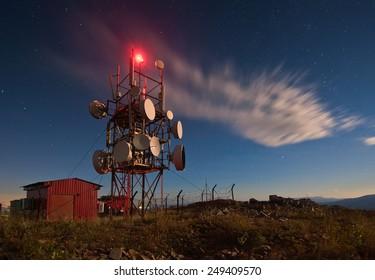 Communication tower at night.