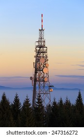 Communication Tower with Parabolic and GSM Antennas on Dusk Blue Sky, Located in The Czech Republic - Cerna Studnice