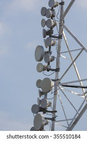 Communication tower and satellite dishes on blue sky background in Cali, Colombia