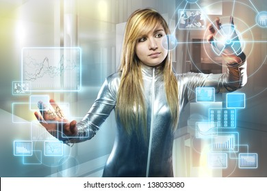 communications concept, beautiful blonde with silver latex jumpsuit with digital tablet