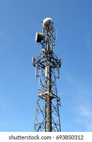 Communications Tower with a Blue Sky Background
