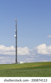 communications tower in the field and sky