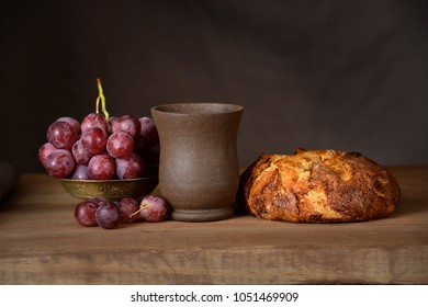 Communion elements on vintage table over dark background