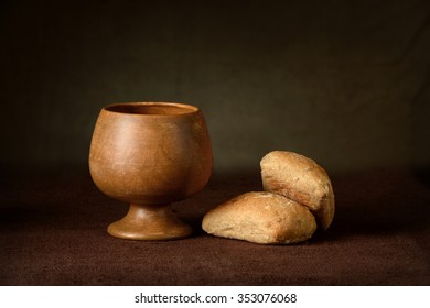Communion elements with wine cup and bread on table