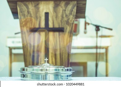 communion tray on table with blurred  pulpit with Jesus cross in church service, can be used for christian background