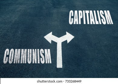 Communism vs capitalism choice concept, two direction arrows on asphalt.