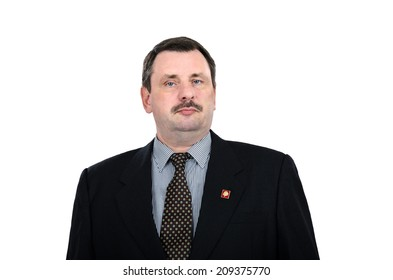Communist man in black suit posing with Lenin badge. Picture taken on white background