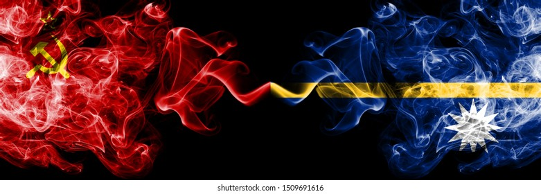 Communist vs Nauru abstract smoky mystic flags placed side by side. Thick colored silky smoke flags of Communism and Nauru