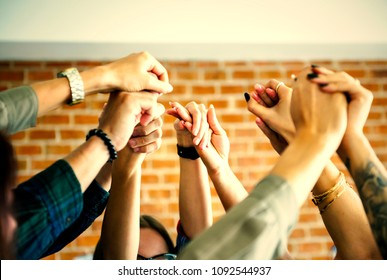Community group holding hands in support