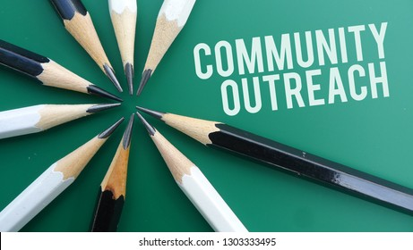 Community Outreach text memo written on a green background with pencils