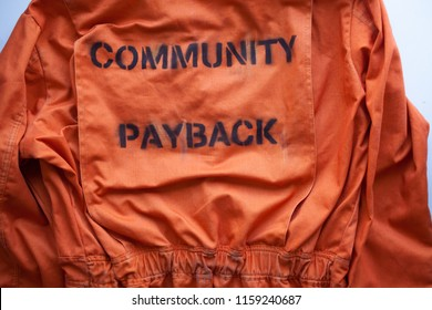 community payback. close up. Prison clothes, jumpsuit sentenced to correctional labor, criminal penalties