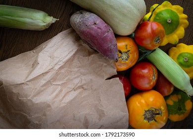 Community Supported Agriculture (CSA) paper bag of fresh organic vegetables.