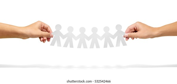 Community, unity and teamwork concept - hands holding paper chain people over white background