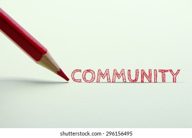 Community word is standing on the paper with red pencil aside.