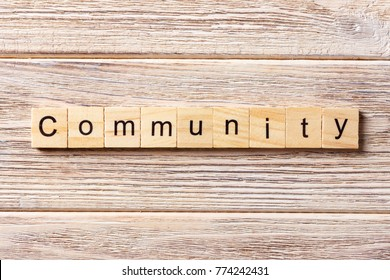 Community word written on wood block. Community text on table, concept.