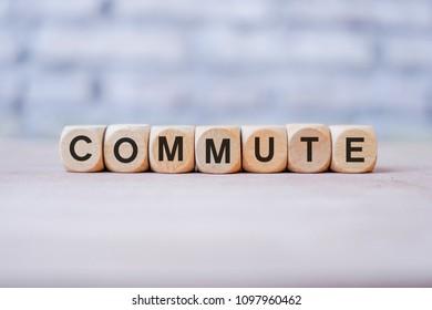 Commute word written on wood block
