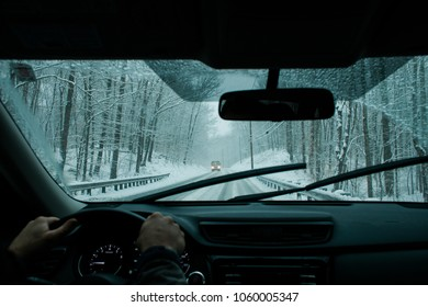 A commuter driving in a winter snow storm