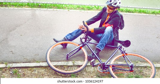 Commuter having bike accident on the way to work - Cyclist knee pain after falling on bicycle on urban cycle lane - Man  holding broken leg due to street cycle crash - Dramatic matte filter look