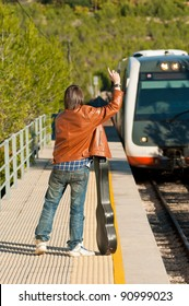 Commuter stopping a small regional train