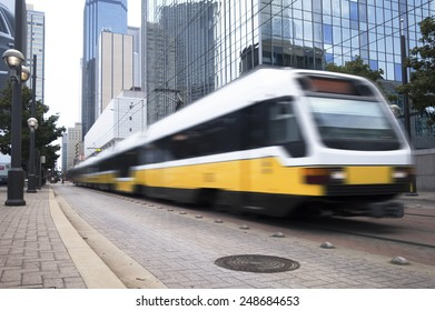 Commuter train traveling through the downtown business district