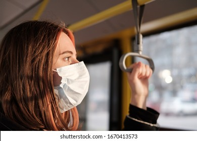 Commuter wears a protective mask in public transport. Coronavirus, COVID-19 spread prevention concept, responsible social behaviour of a citizen