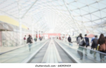 Commuters. Background with an intentional blur effect applied. Humans and location not recognizable.