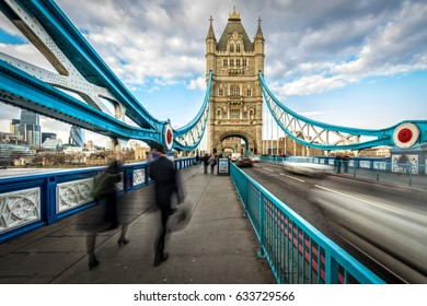 Commuters crossing Tower Bridge during rush hour. Tower Bridge links the South of River Thames to the City area.