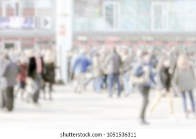 Commuters crowd. Background with an intentional blur effect applied.
