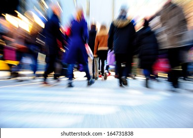 Commuters in motion blur
