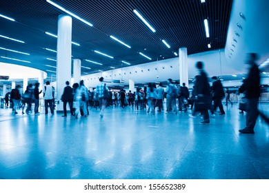 commuters in rush hour with subway transfer center hall