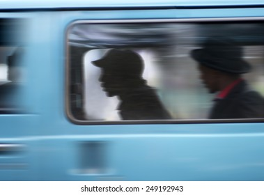 Commuters In Taxi