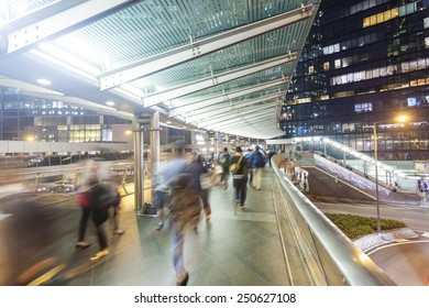 Commuters walking along an elevated walkway in downtown district in Hong Kong