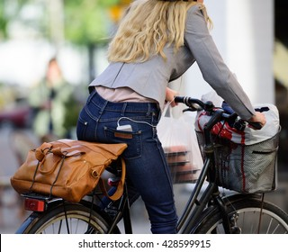 Commuting business woman on bike