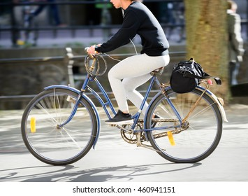 Commuting student woman on bike