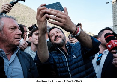 COMO, APRIL 1, 2019: Italian interior minister, Matteo Salvini, make selfie among his supporters while reaching the stage for his campaign speech in Como, Italy on Monday, April 1, 2019.