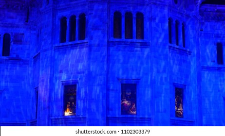 COMO, ITALY - CIRCA DECEMBER 2017:   Christmas lighting projected on the Cathedral and on the buildings in the center of the city of Como, Lombardy, Italy.