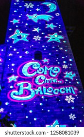"COMO, ITALY, DECEMBER 2018: Christmas time Como's city hall is being lightened. It's time this event "" Como citta' dei balocchi"" takes place,"