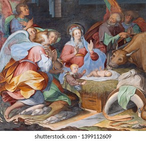 COMO, ITALY - MAY 8, 2015: The fresco of Adoration of Magi in church Basilica di San Fedele by unknown artist of 16. cent.