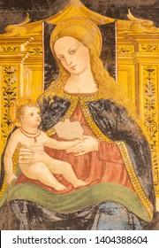 COMO, ITALY - MAY 8, 2015: The detail of fresco of Madonna in church Basilica di San Fedele by Andreas de Magistris 1504.