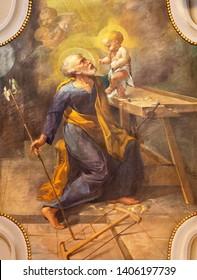 COMO, ITALY - MAY 9, 2015: The fresco of St. Joseph in church Chiesa di San Andrea Apostolo (Brunate) of by T. Conconi (1936).