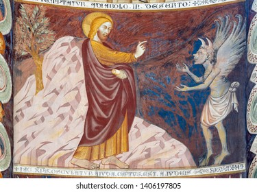 """COMO, ITALY - MAY 9, 2015: The old fresco of Temptation fo Jesus on the mount in church Basilica di San Abbondio by unknown artist """"Maestro di Sant'Abbondio"""" (1315 - 1324)."""