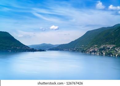Como Lake landscape. Cernobbio village, trees, water and mountains. Italy, Europe.