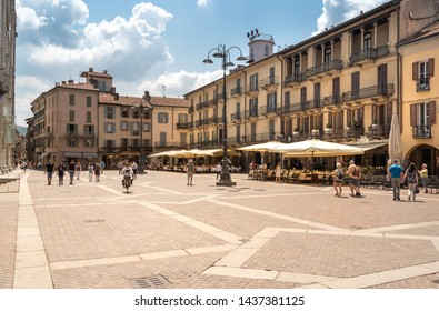 Como, Lombardy, Italy - June 18, 2019: View of Duomo square with traditional Italian street cafe in the historic center of Como, Italy.