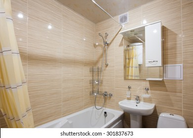The compact bathroom is located in the hotel