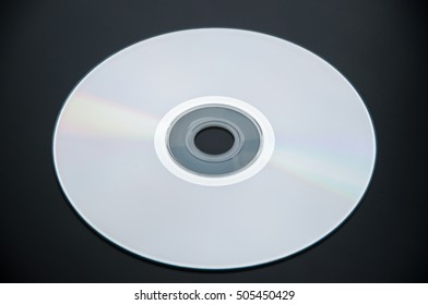 compact disc on black background