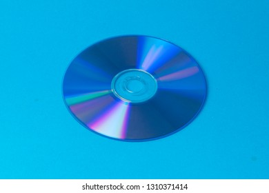 compact disc on blue background